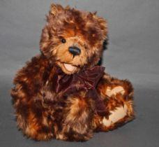 "A soft plush ""Nic Nak"" Charlie Bear, CB0104393, having brown fur covered body, open mouth,"
