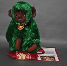 """A soft plush """"Spruce"""" Charlie Bear, CB621344, having a green and brown tinged fur body,"""