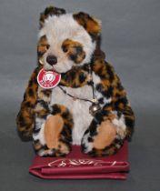 "A soft plush ""Bart"" Charlie Bear, CB124917A, having fawn fur covered body, leopard print limbs,"