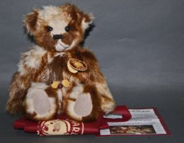 """A soft plush """"Tickle"""" Charlie Bear, CB630310D, having a beige and brown long fur covered body,"""