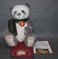 "A soft plush ""Iggy"" Charlie Bear, CB621318, having grey and winter white fur covered body,"
