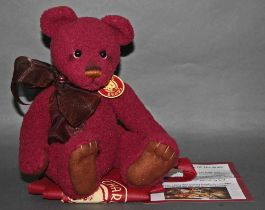 "A soft plush ""Clause"" Charlie Bear, CB121338, having a burgundy coloured woven body,"