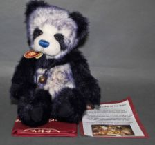 "A soft plush ""Tiffy"" Charlie Bear, CB604686, having navy blue and white fur covered body,"