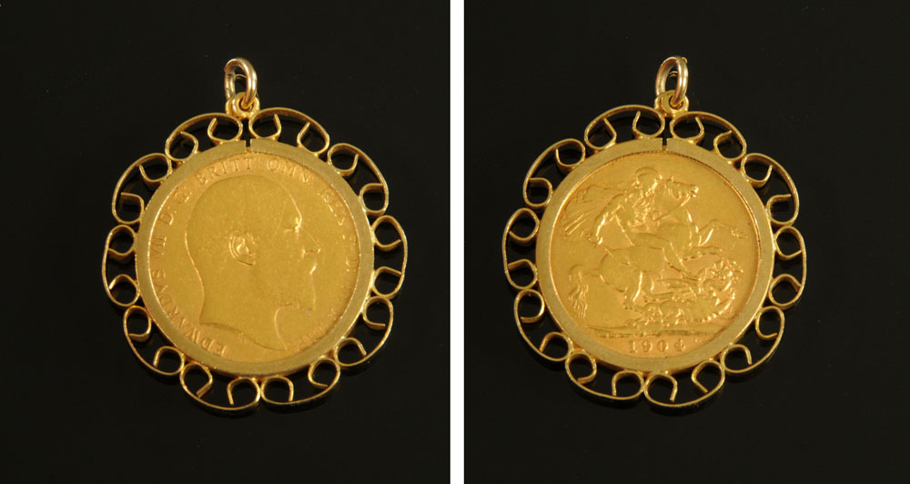 An Edward VII 1904 sovereign, in 9 ct gold pendant mounts.