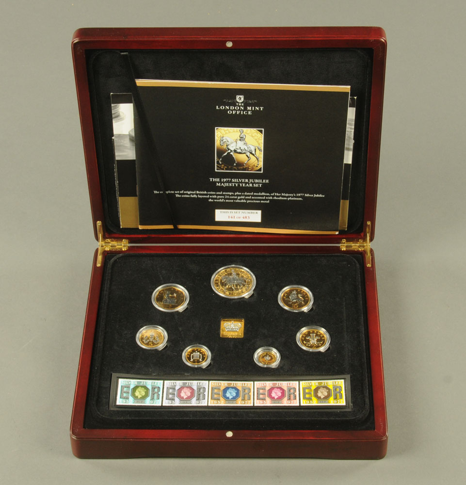 """""""The 1977 Silver Jubilee Majesty Year Set"""" - a set of twelve coins and stamps issued by The London - Image 2 of 2"""