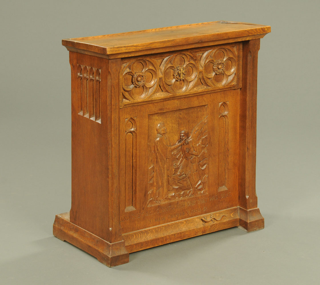 A Lizardman carved oak Gothic style lectern, with typical trademark carved lizard.