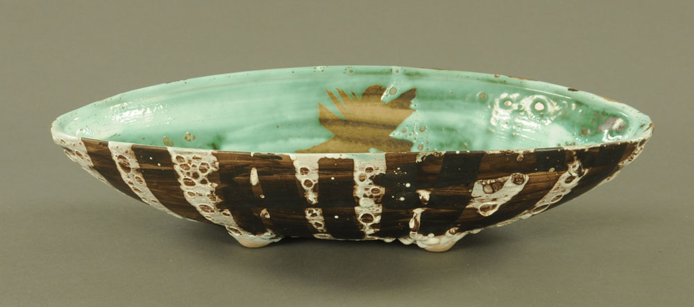 A Rye pottery oval bowl signed Sharp, blue, white and brown glazed. Length 44 cm, depth 20 cm.