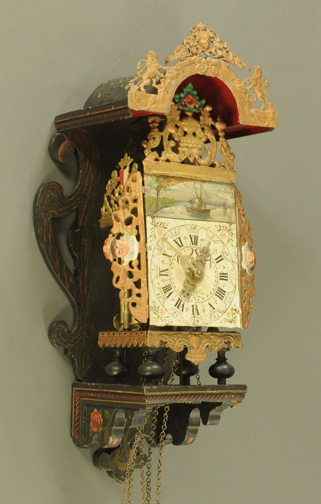A 19th century Dutch alarm wall clock, with weight driven movement,
