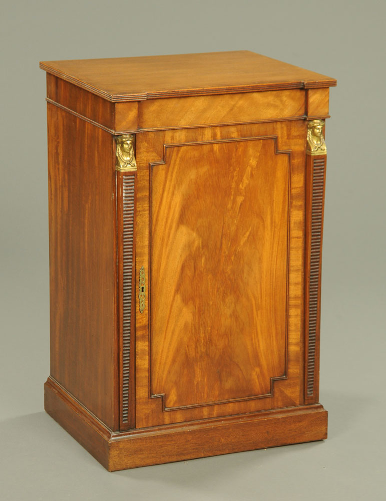 A Regency style mahogany cabinet, with lift up top,