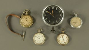 A vintage car clock together with three pocket watches and a stopwatch.
