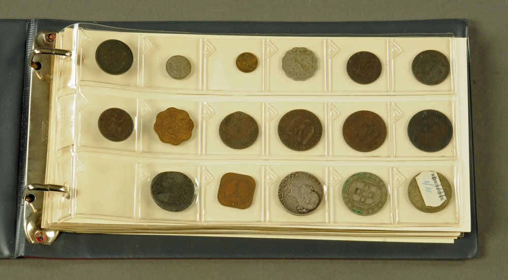 An album of seventy three interesting old coins, including a Victorian 1858 penny.
