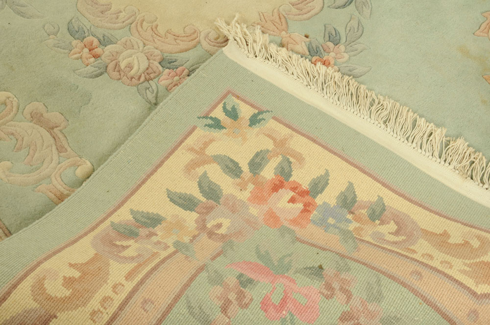 A Chinese woollen carpet, foliate patterned with green and beige ground. - Image 4 of 4
