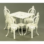 A set of four Victorian style white painted alloy garden chairs, together with a matching table.