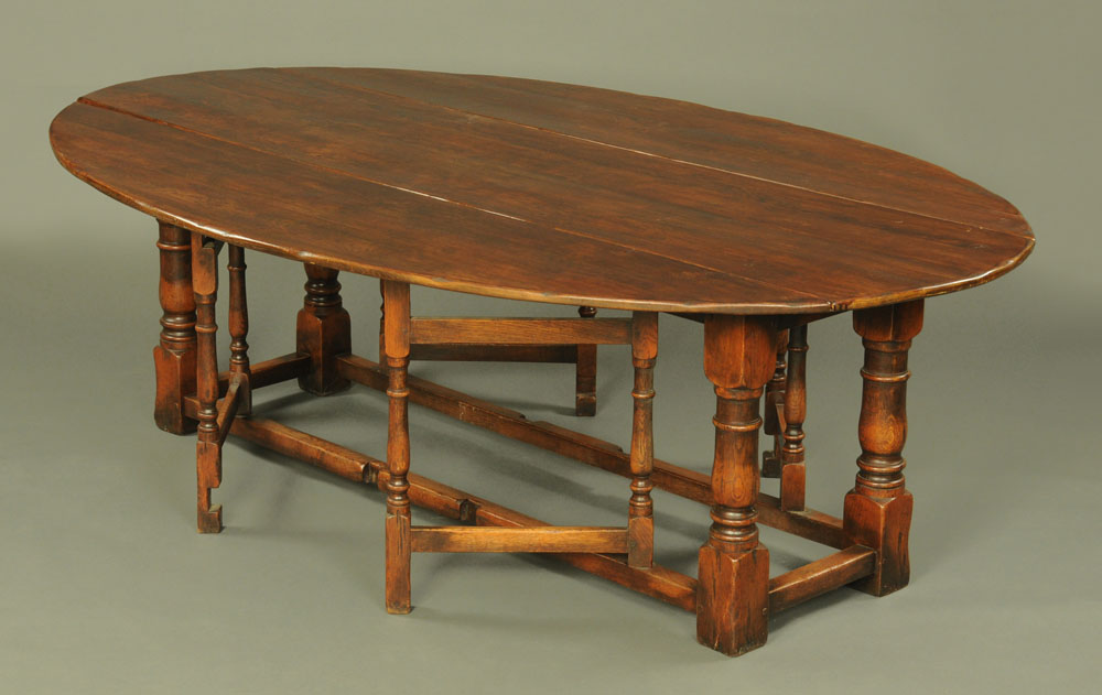 A large oak wake table, twin drop flap with turned supports and double gatelegs with low stretchers. - Image 2 of 2