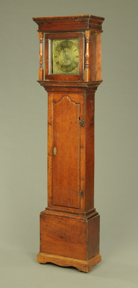 An 18th century oak longcase clock with thirty hour movement and single pointer,