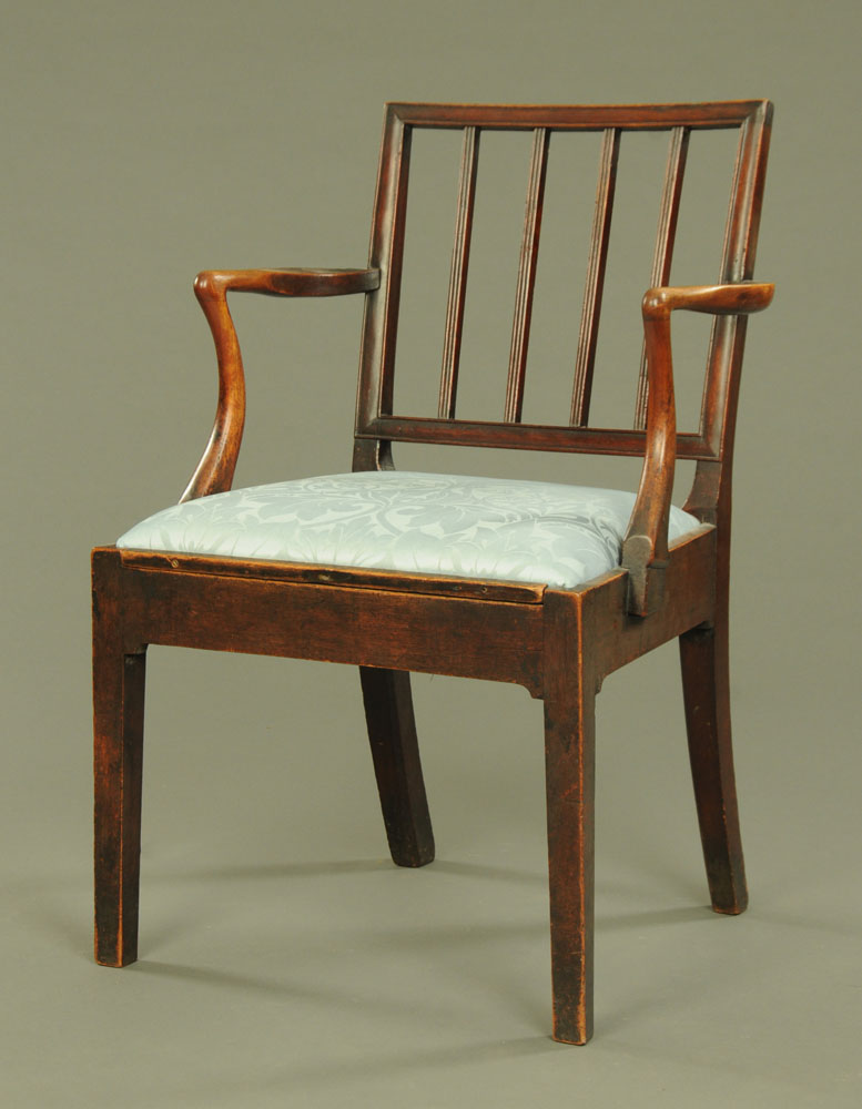 A George III mahogany armchair of Sheraton design with square back, with shepherds crook arms,