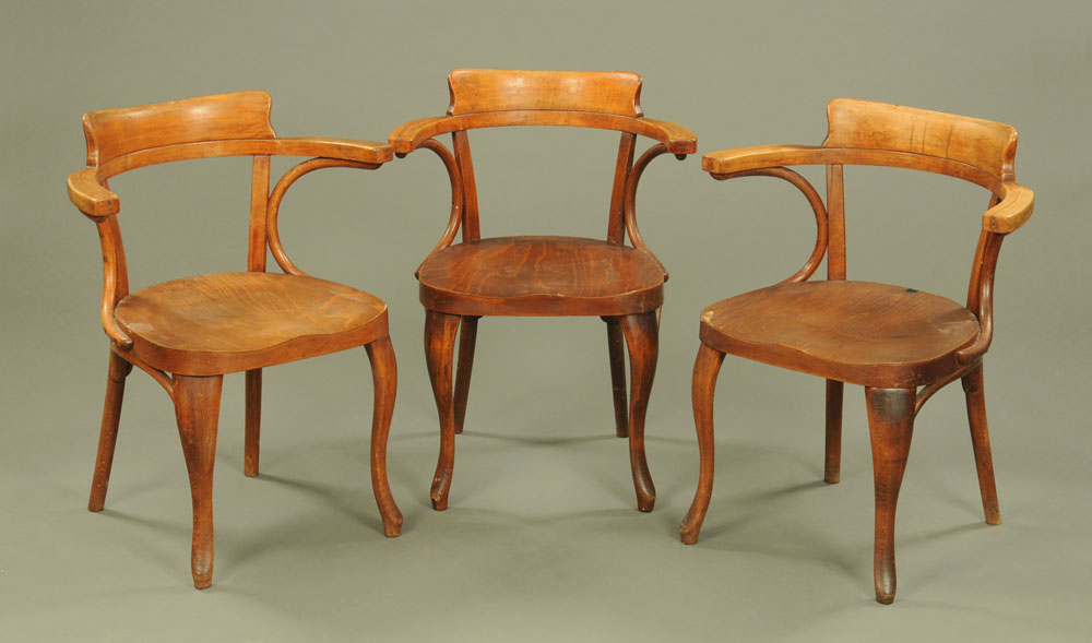 A Set of three 1920's laminated stained beech wood office armchairs by Thonet with labels to