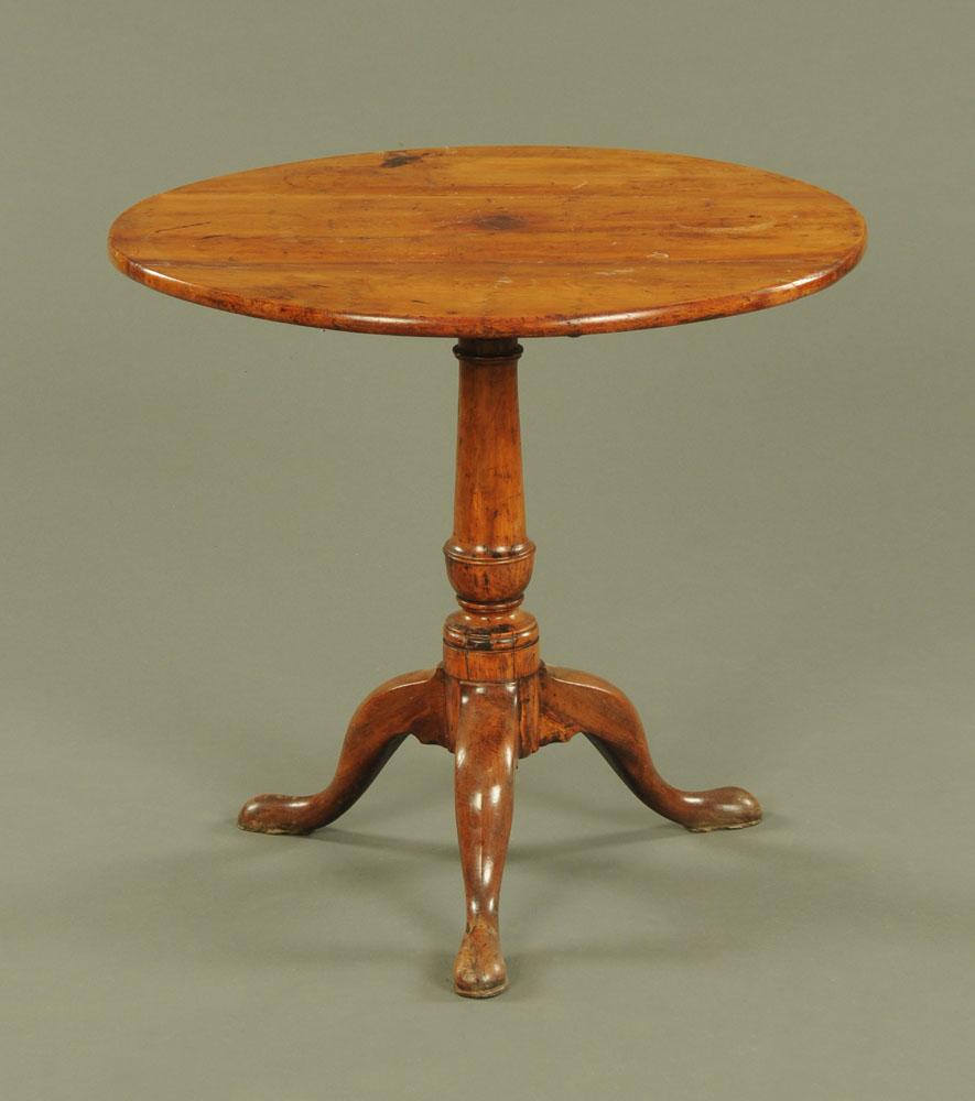 A 19th century tripod table,