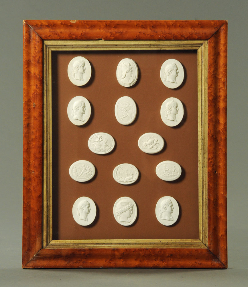 A set of fourteen 19th century plaster oval intaglios, depicting Roman Emperors and scenes,