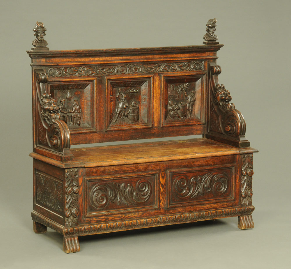 A late 19th century continental carved oak box settle,