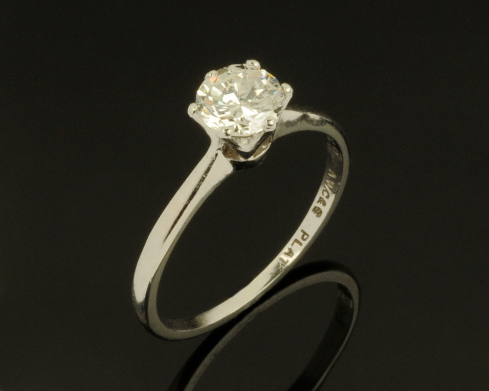 A platinum solitaire diamond ring, the brilliant cut diamond claw set, stamped L42AWC & S Plat.
