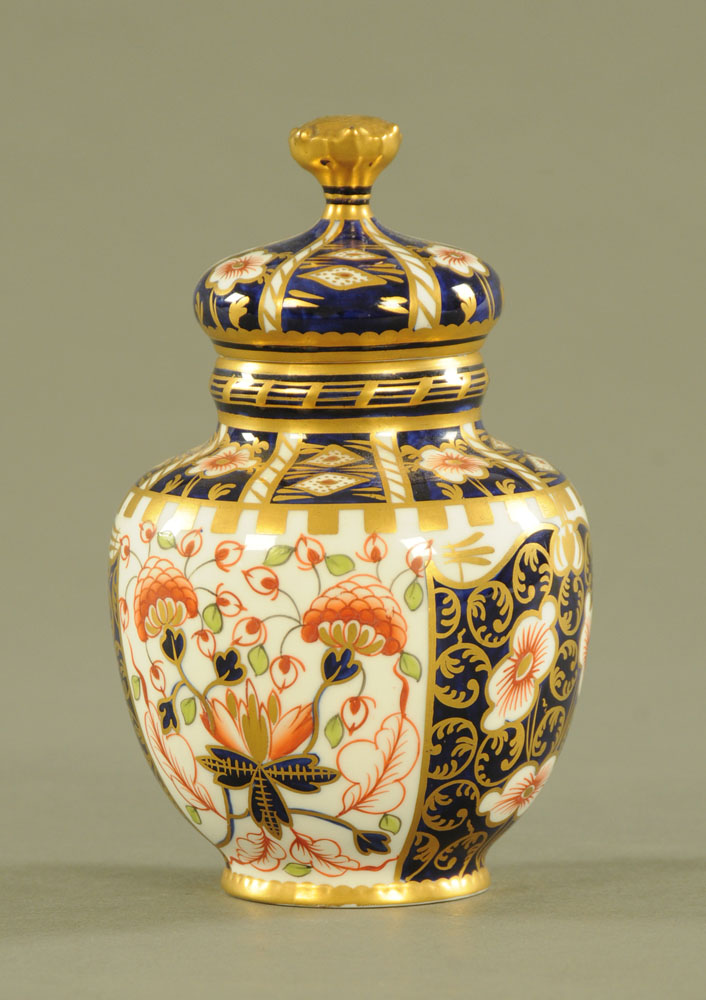 A Royal Crown Derby lidded vase, with printed mark to base. Height 14.5 cm.