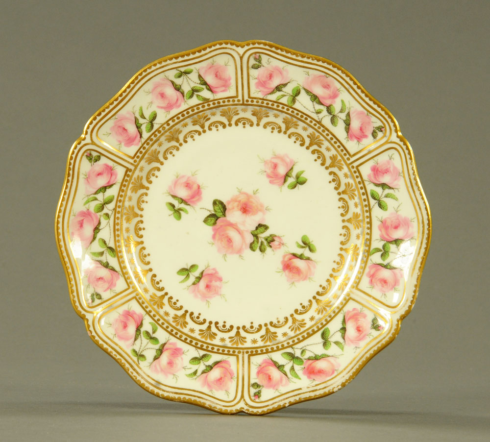 An early 19th century Swansea porcelain circular plate with shaped rim,