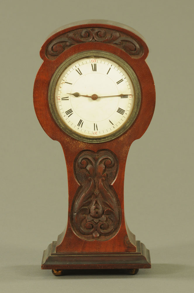 An Art Nouveau mahogany cased mantle clock, with single train movement. Height 27 cm, width 13 cm.