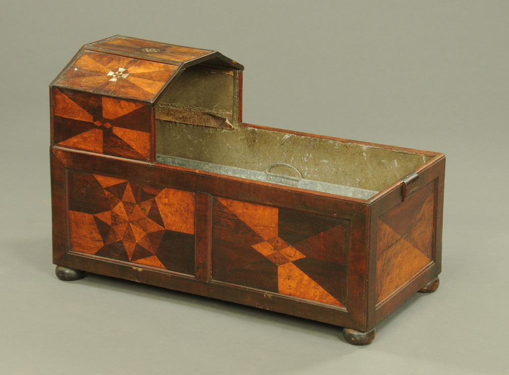 A 19th century parquetry crib, with later galvanised liner for logs.