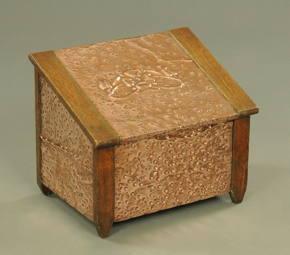 An early 20th century oak and copper slope front coal receiver. Width 48 cm.