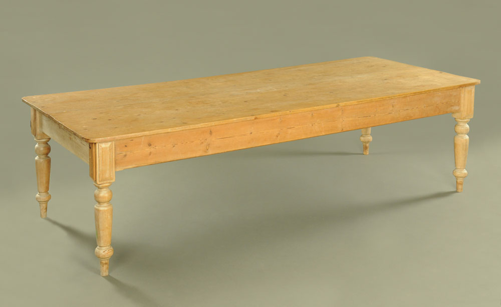 A Victorian pine kitchen table, with five plank top on turned legs.