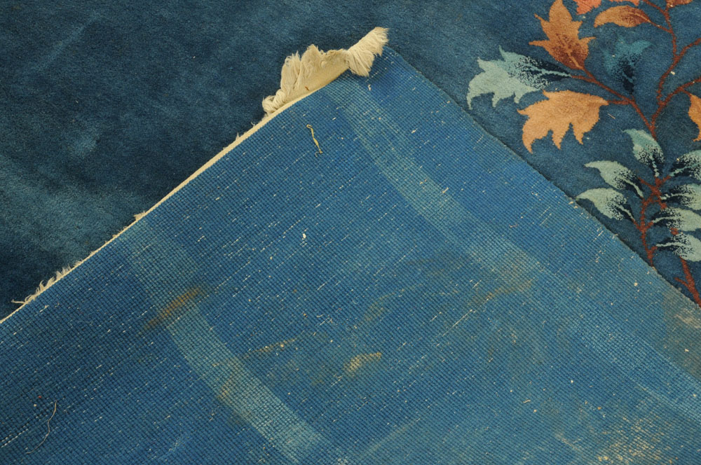 A large Chinese blue ground foliate patterned carpet with fringed ends. - Image 6 of 8