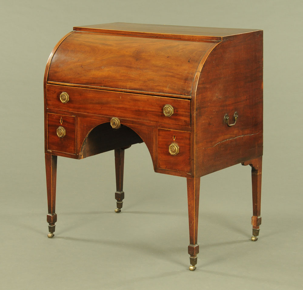 A Regency mahogany cylinder bureau, the long drawer opening and operating the roll,