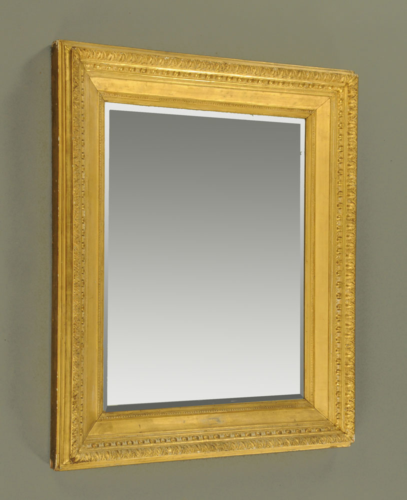 A 19th century giltwood rectangular wall mirror with bevelled plate,