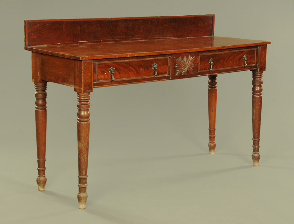 A Victorian mahogany serving table with upstand and fitted two drawers on turned legs,