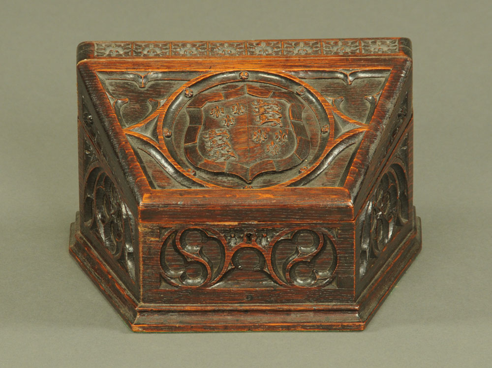 A Victorian carved oak stationery box with angled sides,