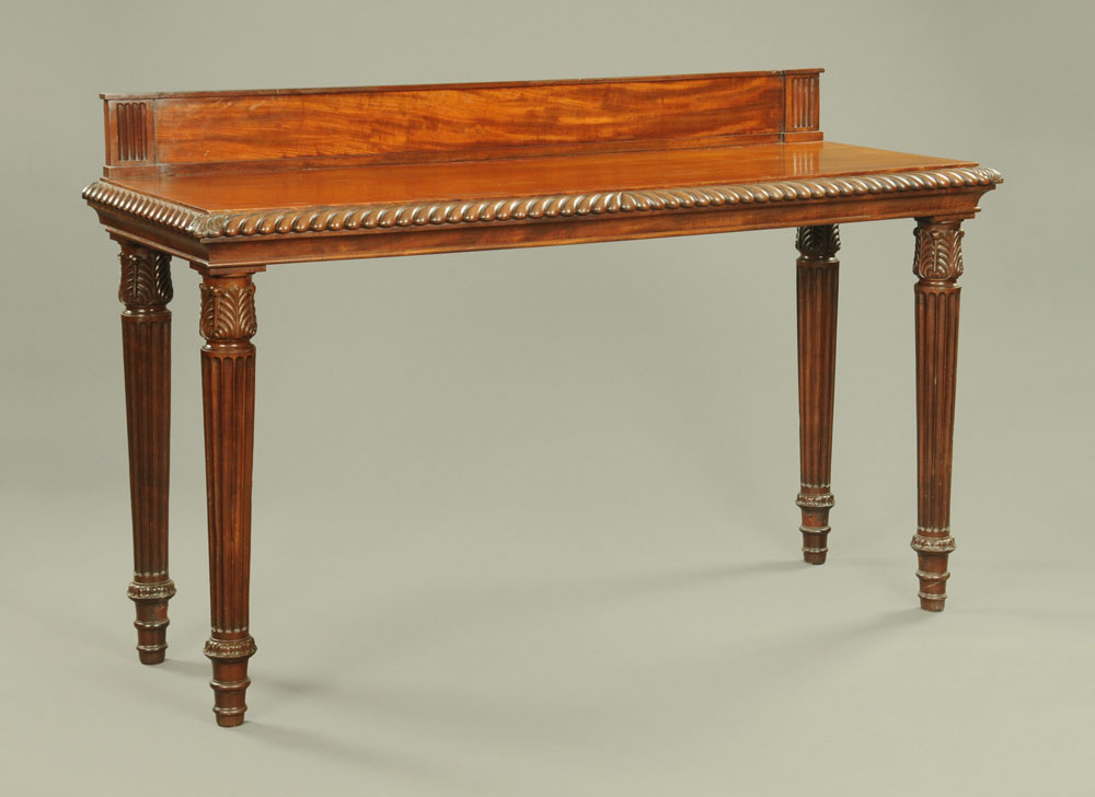 An early 19th century mahogany hall or serving table, with rear upstand,