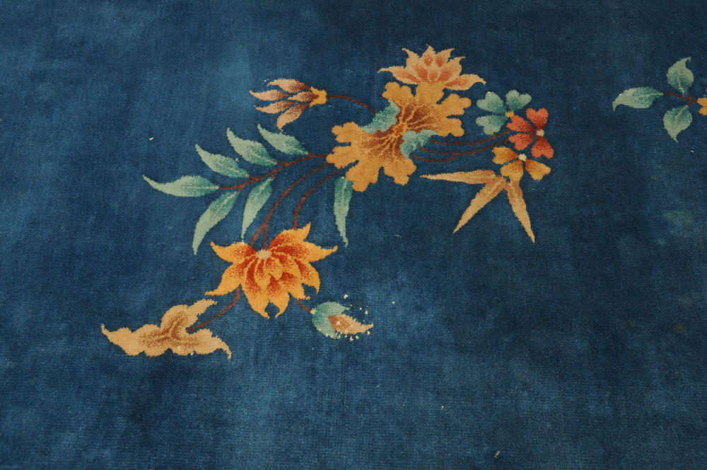 A large Chinese blue ground foliate patterned carpet with fringed ends. - Image 5 of 8