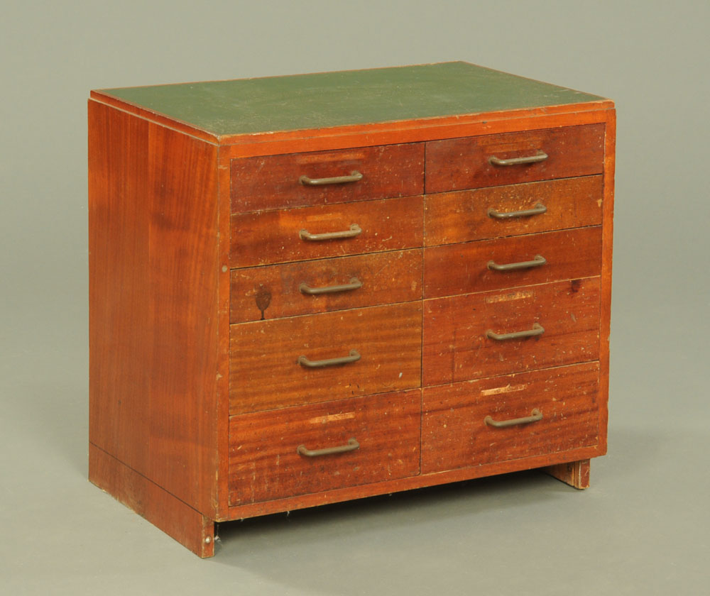 A mid century stained beechwood engineers workshop drawers, the top inset with green rexine.