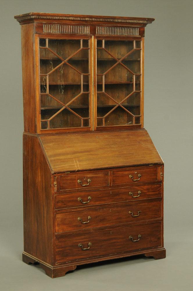 A Georgian mahogany bureau bookcase. Height 213 cm, width 122 cm, depth 55 cm.
