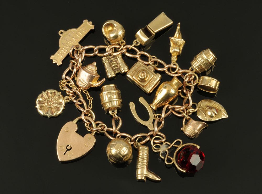 A 9 ct gold charm bracelet, 30.8 grams gross (see illustration).