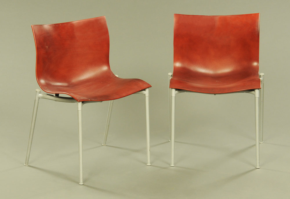 A pair of Philip Starck red plastic and aluminium Cam El Eon chairs by Driade.