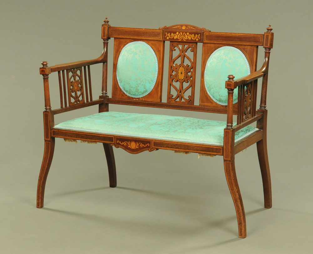 An Edwardian inlaid mahogany two seat salon settee with pierced back and sides,