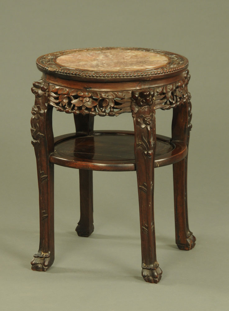 A 19th century Chinese hardwood rouge marble topped jardiniere stand,