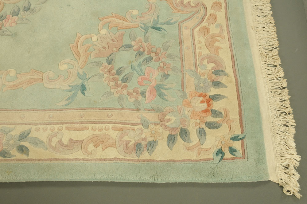 A Chinese woollen carpet, foliate patterned with green and beige ground. - Image 2 of 4