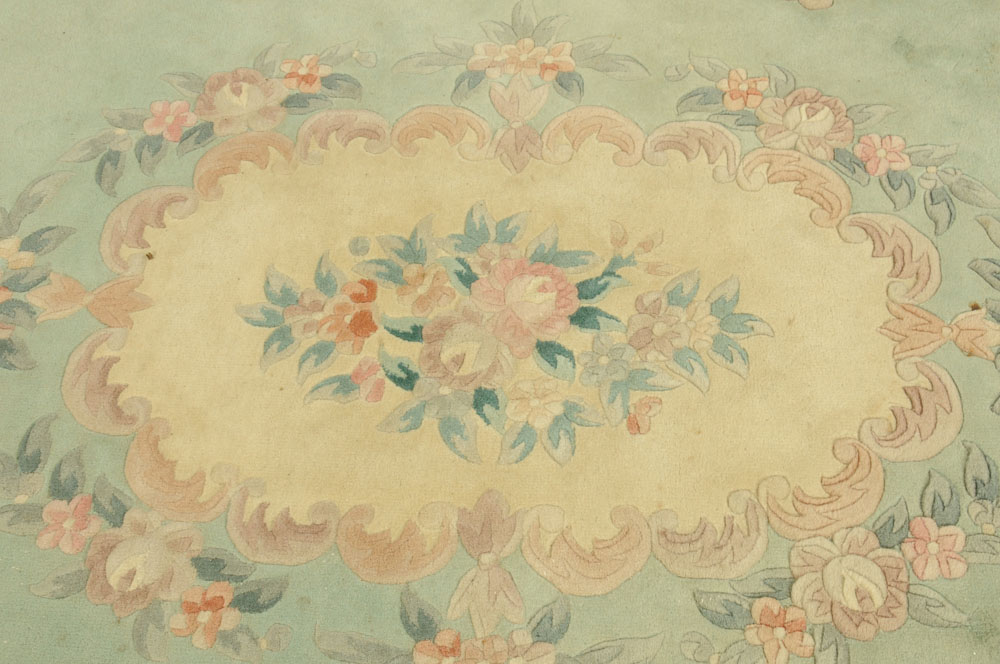 A Chinese woollen carpet, foliate patterned with green and beige ground. - Image 3 of 4