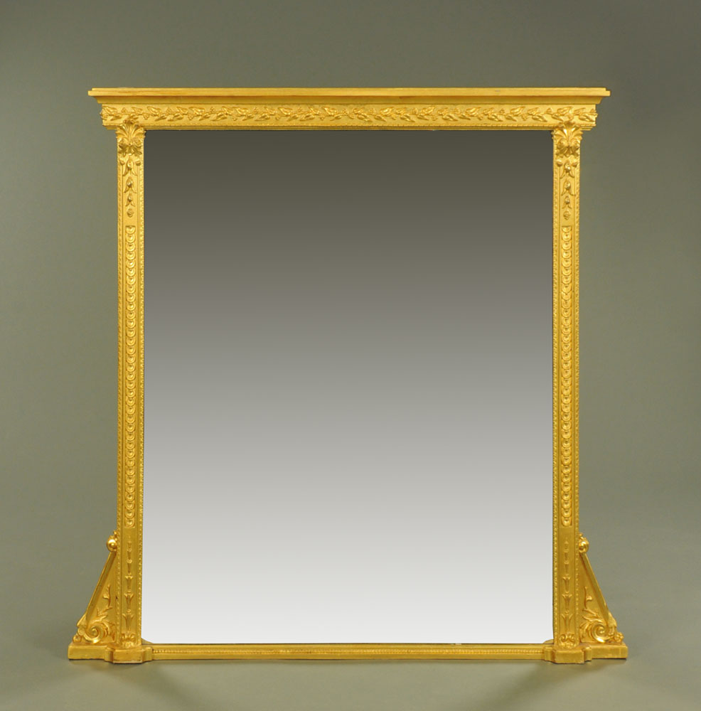 A large late 19th century gilt wood overmantle mirror, with moulded cornice and leaf,