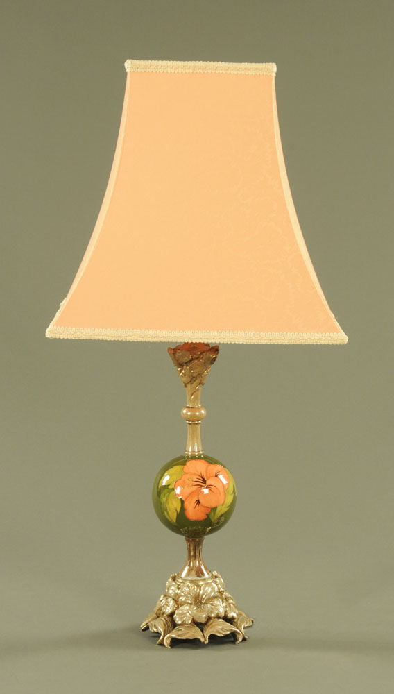 A Moorcroft table lamp, with composition base and light fitting.