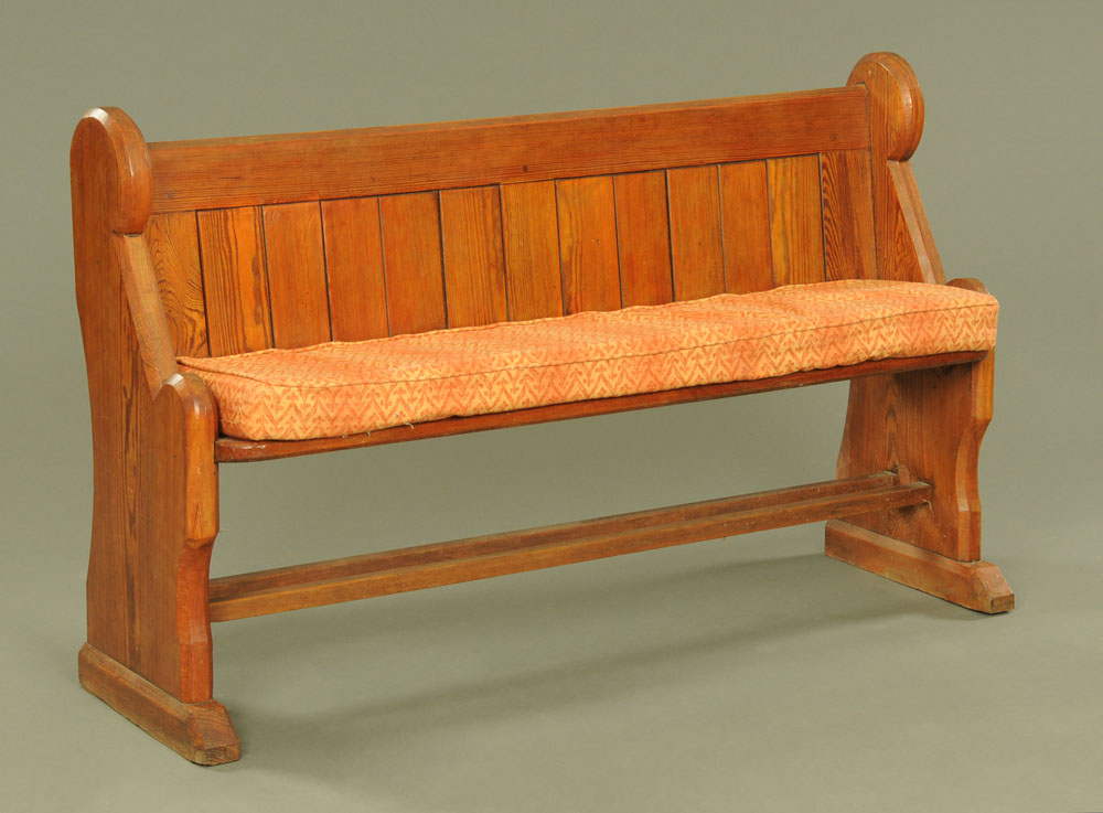 A late Victorian pitch pine pew, 145 cm wide.