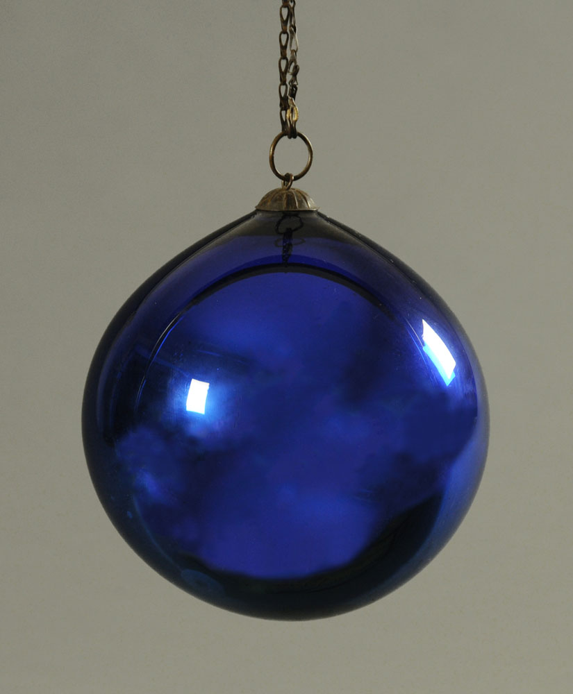 A late 19th/early 20th century iridescent blue glazed glass witches ball,